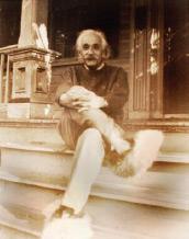 Einstein sitting on the front steps