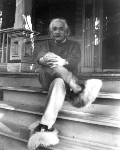 Albert Einstein sits on the porch of his home at 112 Mercer Street