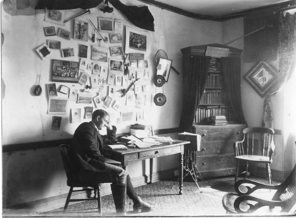 A student reads in his room at the Princeton Theological Seminary, ca. 1900.